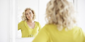 o-MATURE-WOMAN-LOOKING-IN-MIRROR-facebook